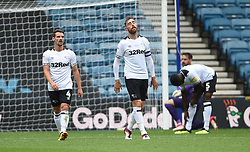 Derby County's Richard Keogh shows dejection as goalkeeper Scott Carson is beaten for the second goal scored by Millwall's Shaun Williams with a large deflection
