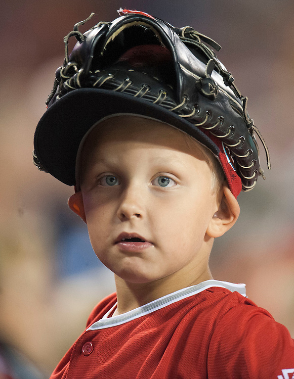 A young Angel fan wears his glove on his head during the Angels' 5-2 loss to the St. Louis Cardinals Wednesday night at Angel Stadium.<br /> <br /> ///ADDITIONAL INFO:   <br /> <br /> angels.0512.kjs  ---  Photo by KEVIN SULLIVAN / Orange County Register  --  5/11/16<br /> <br /> The Los Angeles Angels take on the St. Louis Cardinals at Angel Stadium Wednesday.<br /> <br />  5/11/16