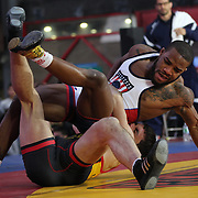 Jordan Burroughs, (right), USA, in action against  Atsamaz Sanakoev, Russia, during the 'Beat The Streets' USA Vs The World, International Exhibition Wrestling in Times Square. New York, USA. 7th May 2014. Photo Tim Clayton