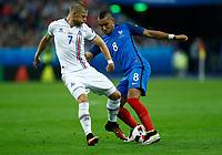 Johann Gudmundsson (Iceland) and Dimitri Payet (France) <br /> Paris 03-07-2016 Stade de France Football Euro2016 France - Iceland / Francia - Islanda Quarter finals <br /> Foto Matteo Ciambelli / Insidefoto