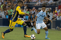September 20, 2017 - Kansas City, Kansas, U.S - Sequence 04-01: Sporting KC forward Latif Blessing #9 (r) and NY Red Bulls defender Michael Amir Murillo #62 (l) vie for sideline advantage during the first half of the game. Sporting KC will win the 2017 Lamar Hunt Open Cup championship with a score of 2-1 over the New York Red Bulls. (Credit Image: © Serena S.Y. Hsu via ZUMA Wire)
