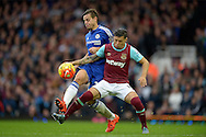 Cesar Azpilicueta of Chelsea tackles Mauro Zarate of West Ham United. Barclays Premier League, West Ham Utd v Chelsea at The Boleyn Ground, Upton Park in London on Saturday 24th October 2015.<br /> pic by John Patrick Fletcher, Andrew Orchard sports photography.
