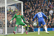 Goalkeeper Fraser Forster of Southampton saves a close range header from Eden Hazard of Chelsea. Barclays Premier league match, Chelsea v Southampton at Stamford Bridge in London on Sunday 15th March 2015.<br /> pic by John Patrick Fletcher, Andrew Orchard sports photography.