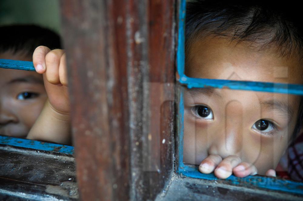 Vietnamese boys look at the camera through a window, Nha Trang, Vietnamese, Southeast Asia