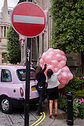Secure pink balloons due to be released during a PR event for the Langham Hotel in central London, UK.