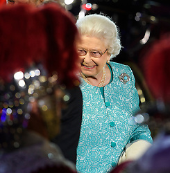 © Licensed to London News Pictures. 15/05/2016. Windsor, UK.  HRH QUEEN ELIZABETH II arrives at in the arena . An evening event held at the Royal Windsor Horse show to celebrate the 90th birthday of HRH Queen Elizabeth II. Acts from arounds the world have been invited to perform at the evening event, set in the grounds of Windsor Castle. Photo credit: Ben Cawthra/LNP