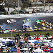 NASCAR Sprint Cup Series drivers Michael Waltrip (15), Andy Lally (71), Joe Nemechek (87) Greg Biffle (16) and David Reutimann (00) are involved in a multi car crash during the Daytona 500 at Daytona International Speedway. on February 20, 2011 in Daytona Beach, Florida. (AP Photo/Alex Menendez)