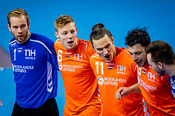 The Dutch handball players (L-R) Bart Ravensbergen, Niko Blaauw, Iso Sluijters during the European Championship qualifying match against Slovenia on January 6, 2020 in Topsportcentrum Almere