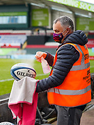 A steward disinfects a ball before a Gallagher Premiership Round 10 Rugby Union match, Friday, Feb. 20, 2021, in Leicester, United Kingdom. (Steve Flynn/Image of Sport)