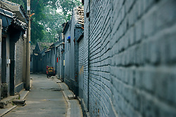 Traditional grey walls of a narrow alleyway or Hutong in Beijing