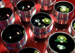 """Finshed """"lens heads"""" for the Leica Noctilux-M 50mm f-0.95 ASPH. Leica claims this is the fastest aspherical lens in the world. Priced at $11,000 each, this tray of lenses represents over $100,000 of prime Leica glass. (Photo © Jock Fistick)"""
