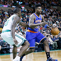 26 March 2013: New York Knicks small forward Iman Shumpert (21) drives past Boston Celtics power forward Brandon Bass (30) during the New York Knicks 100-85 victory over the Boston Celtics at the TD Garden, Boston, Massachusetts, USA.