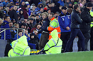 a pitch invader is led away. The Emirates FA cup, 3rd round match, Everton v Dagenham & Redbridge at Goodison Park in Liverpool on Saturday 9th January 2016.<br /> pic by Chris Stading, Andrew Orchard sports photography.