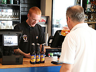 AFC Wimbledon fan buying AFC Wimbledon beer during the Pre-Season Friendly match between AFC Wimbledon and Burton Albion at the Cherry Red Records Stadium, Kingston, England on 21 July 2017. Photo by Matthew Redman.