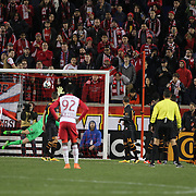 Goalkeeper Joe Willis, Houston Dynamo, is beaten by a free kick from Felipe Martins, (right), New York Red Bulls, for the second of his two spectacular goals in New York Red Bulls 4-3 win during the New York Red Bulls Vs Houston Dynamo, Major League Soccer regular season match at Red Bull Arena, Harrison, New Jersey. USA. 19th March 2016. Photo Tim Clayton