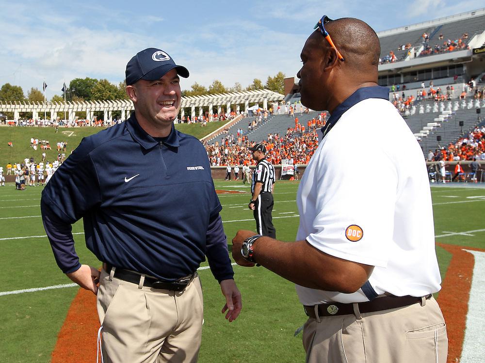 Penn State head coach Bill O'Brien, left, talks with Virginia head coach Mike London during an NCAA college football game in Charlottesville, Va. Virginia defeated Penn State 17-16.