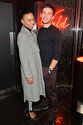 PIPPA BENNETT-WARNER and JONATHAN BAILEY at Rock The Empire - a party hosted by Alexa Chung to celebrate the launch of W Beijing - Chang'an held at the Wyld Bar, W London, Leicester Square, London on 19th February 2015.