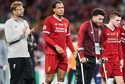 A dejected Jurgen Klopp manager of Liverpool, Virgil Van Dijk of Liverpool, injured teammate Alex Oxlade-Chamberlain and Andy Robertson of Liverpool at the end of the UEFA Champions League final between Real Madrid and Liverpool on May 26, 2018 in Kiev, Ukraine.Photo by Andriy Yurchak / Sportida