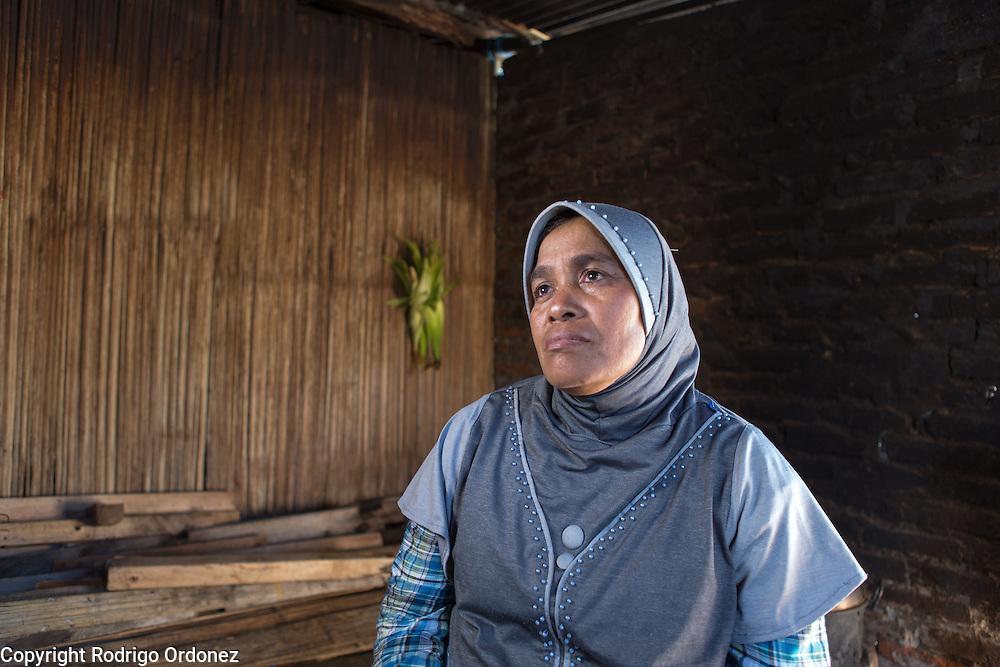 Siti Rofi'ah, 45, poses for a photograph at her home in Lewoleba, Nubatukan subdistrict, Lembata district, East Nusa Tenggara province, Indonesia.