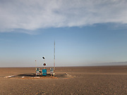 An abandoned gas station, equipped with a lightning rod, sits in the empty steppe of the Gobi desert. <br /> <br /> Road trip with a Jeep in the Gobi region.
