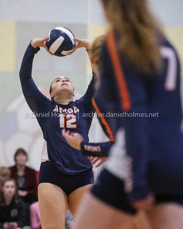 (10/24/18, MARLBOROUGH, MA) AMSA's Julie Cavalcanti sets the ball during the volleyball game against Hopedale at ForeKicks  in Marlborough on Wednesday. [Daily News and Wicked Local Photo/Dan Holmes]