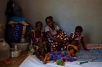 Asylum seekers from Ivory Coast pass the time at a<br /> UNHCR-sponsored makeshift refugee camp in Bossou village, southeast<br /> Guinea, December 15th, 2010. Nearly 4,000 refugees fro Ivory Coast<br /> have fled into neighboring Guinea and Liberia in the past two weeks.
