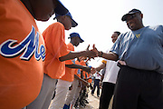 Former MLB players Dusty Baker (right) and Dave Winfield (second from right) greet Ghanaian boys after an exhibition baseball game in the city of Tema, roughly 35 km east of Ghana's capital Accra on Saturday February 3, 2007. The game was being held on the occasion of the visit of a delegation from the American Major League Baseball Association made possible by the African Development Foundation, a non-profit organization that supports little league projects in selected African countries.