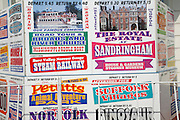 Adverts outside travel agency for local day trips from Great Yarmouth, Norfolk, England