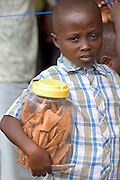Young boy selling sweets, Ghana, West Africa.