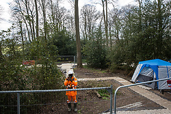 Wendover, UK. 9th April, 2021. A HS2 contractor uses a mobile phone to film a press photographer during tree felling operations for the HS2 high-speed rail link in Jones Hill Wood. Tree felling work began this week, in spite of the presence of resting places and/or breeding sites for pipistrelle, barbastelle, noctule, brown long-eared and natterer's bats, following the issuing of a bat licence to HS2's contractors by Natural England on 30th March.