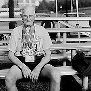 Senior athlete John Boesenhofer, 92 (born November 14, 1914) is photographed with all his medals after competing in the track and field competition at the 2007 Senior Olympics, held at the University of Louisville's Cardinal Park Soccer & Track Stadium in Louisville, Kentucky on June 29, 2007. ..The event was sponsored by the National Senior Games Association, established in 1986, which oversees 50 state and 350 local and regional competitions for senior athletes in the United States each year. There are an estimated 250,000 senior athletes in training in the U.S. ...
