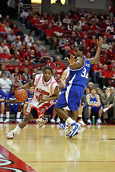 "27 January 2008: Keith ""Boo"" Richardson attacks from the baseline passing Todd McCoy as he rounds the corner in a game where the Indiana State Sycamores were cut down by the Illinois State Redbirds 65-62 on Doug Collins Court at Redbird Arena in Normal Illinois.."