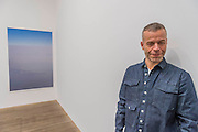 Tillmans with peninsula - Wolfgang Tillmans: 2017. Tate Modern's new exhibition. Highlights include: large scale photographic works printed especially for this exhibition, including the four-meter tall Weed 2014 and dramatic seascapes such as The State We're In, A 2015;   New 'text and table' sculptures including Time Mirrored 3 2017, on display to the public for the first time; and slide projection Book for Architects 2014. The show is at Tate Modern from 15 February to 11 June 2017.