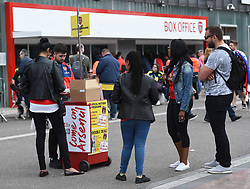 Arsenal fans buying programmes before kick off