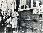 Germany enforced anti-semitism in occupied Poland. Passengers boarding a tram in Warsaw which carried a Jews Only section on the left. 1940-1942.