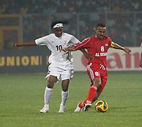 Photo: Steve Bond/Richard Lane Photography.<br />Sudan v Zambia. Africa Cup of Nations. 22/01/2008. Sudan skipper Mustafa Haitham (R) holds off Ian Bakala (L)