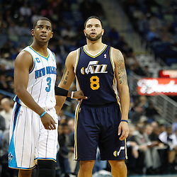 December 17, 2010; New Orleans, LA, USA; New Orleans Hornets point guard Chris Paul (3) and Utah Jazz point guard Deron Williams (8) during the first half at the New Orleans Arena.  The Hornets defeated the Jazz 100-71. Mandatory Credit: Derick E. Hingle