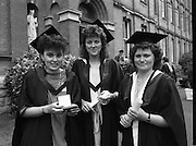 Graduations At Carysfort College.  (R84)..1988..24.07.1988..07.24.1988..24th July 1988..Today at Carysfort College saw the final conferring of degrees on the students in the teacher training programme. The college in Blackrock, Dublin trains students to become primary school teachers after a three year course and is under the control of the Department of Education...Image shows Eilis Ni Lordain, Castletownbere, Cork, Fiona Byrne, Wilton, Cork, and Siobhan Kingston, Dunmanway,Cork after the conferring ceremony.