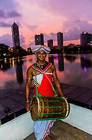 Musicains outside Seema Malaka Temple at twilight, Beira Lake, Colombo, Sri Lanka.