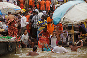 Pilgrims bathing on the Ganges river in Varanasi in India.