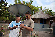 Two men are compairing phone numbers on the island Atauro.  Atauro is an island with 10.000 inhabitants belonging to the state of Timor Leste, 25 km north of the capital Dili. Timor Leste gained independence from Indonesia in May 2002.