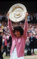Tennis - 1977 Wimbledon Championships Ladies singles Final <br /> Virginia Wade v Betty Stove - Centre Court<br /> <br /> Virginia Wade lifts the Wimbledon trophy.  <br /> <br /> Credit: Colorsport / Andrew Cowie
