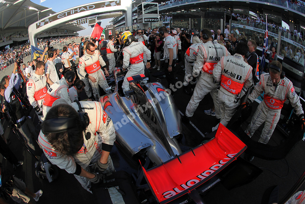 Lewis Hamilton and McLaren-Mercedes mechanics on the grid before the 2009 Abu Dhabi Grand Prix at the Yas Marina Circuit. Photo: Grand Prix Photo
