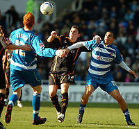 Photo: Ed Godden.<br />Reading v Wolverhampton Wanderers. Coca Cola Championship. 18/03/2006. <br />Wolves' Mark Davies (C) is held off the ball by James Harper (R)