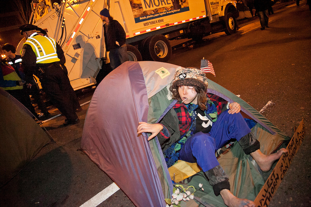 Occupy Boston protesters set up a tent on a street after a midnight deadline in Boston, Massachusetts, December 9, 2011.