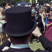 A group of race goers pose for a photograph before the start of the races at Royal Ascot Race Course. Royal Ascot is one of the most famous race meetings in the world, frequented by Royalty and punters from the high end of society to the normal everyday working class. Royal Ascot 2009, Ascot, UK, on Wednesday, June 17, 2009. Photo Tim Clayton..