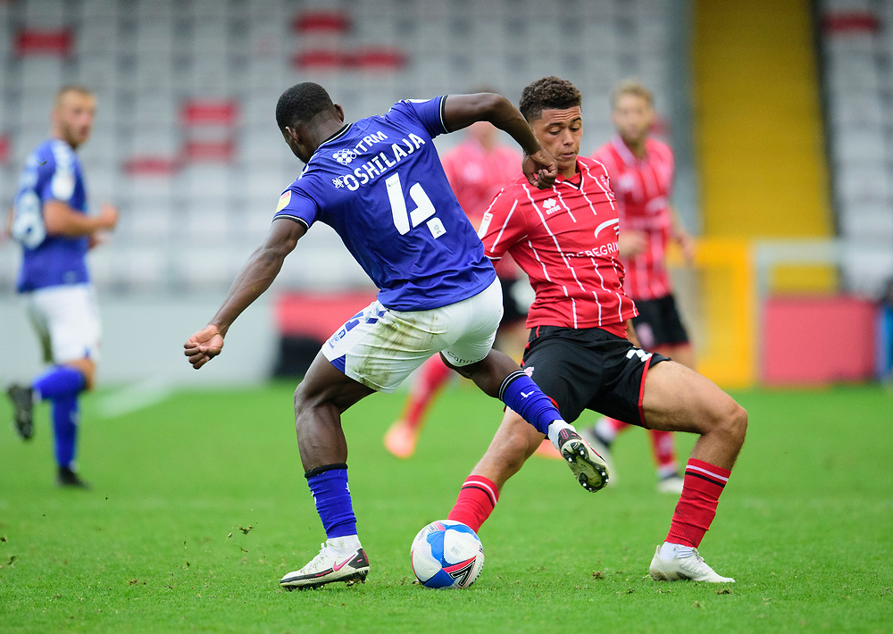 Lincoln City's Brennan Johnson battles with Charlton Athletic's Adedeji Oshilaja<br /> <br /> Photographer Andrew Vaughan/CameraSport<br /> <br /> The EFL Sky Bet League One - Lincoln City v Charlton Athletic - Sunday 27th September, 2020 - LNER Stadium - Lincoln<br /> <br /> World Copyright © 2020 CameraSport. All rights reserved. 43 Linden Ave. Countesthorpe. Leicester. England. LE8 5PG - Tel: +44 (0) 116 277 4147 - admin@camerasport.com - www.camerasport.com