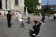Chinese bride has her wedding photos taken outside St Pauls Cathedral in London, England, United Kingdom. This tradition of having your wedding photographs taken around the city in front of famous landmarks is very common in particular amongst Asian couples prior to their wedding day.