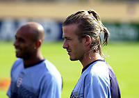 Photo. Glyn Thomas<br />England Training-prior to England v Croatia international friendly.<br />Five Lakes. 19/08/2003.<br />David Beckham (R) is in serious mood at England training.