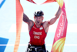 England's Joe Townsend celebrates winning gold in the Men's Para-triathlon Final at the Southport Broadwater Parklands during day three of the 2018 Commonwealth Games in the Gold Coast, Australia.